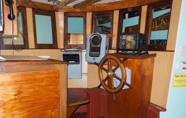 Interior of wheelhouse with wheel and nav gear
